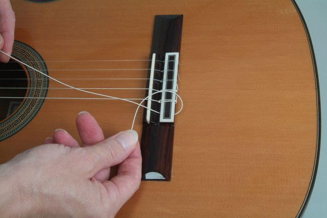 how to tie classical guitar strings the metal wound. Black Bedroom Furniture Sets. Home Design Ideas